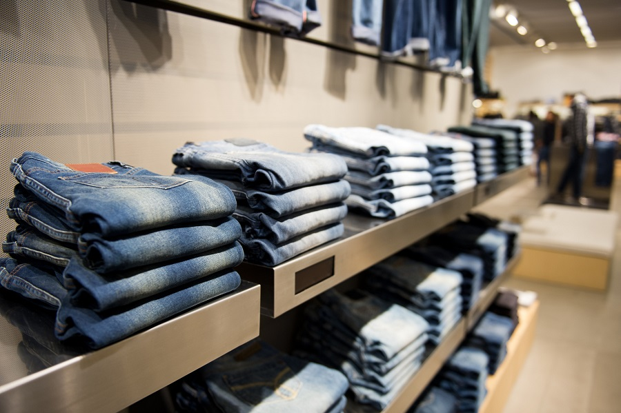 stack of blue jeans in a shop.
